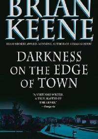 Darkness at the edge of the town - Brian Keene